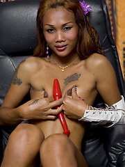 Katoey Em trains her juicy asshole with a red butt plug