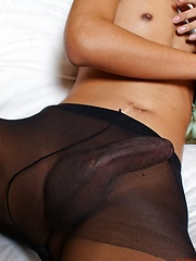 Ladyboy star in black pantyhose gets hard cock