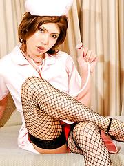 Japanese tranny nurse strips before cameraman
