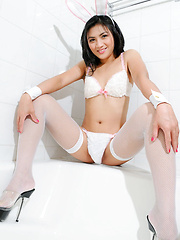 Cute dark-haired tranny in white stockings
