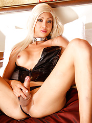 Hung blonde tranny in latex suite