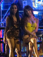 Bangkok street whores with cocks between their sexy legs