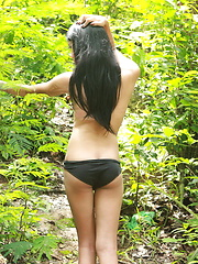 Long haired shemale walking and wanking her dick in a tropical forest