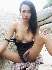 Cute busty Thai cutie playing with her cock outdoors until shooting her load