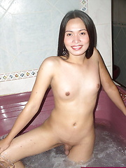 Slim ladyboy ready for the shag in the car-shaped bed of a love-hotel room