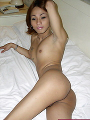 Slim ladyboy stripping on his bed for our voyeuristic pleasure