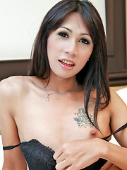 Ladyboy twists her nipples and jerks off
