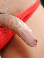 Sultry femboy with an uncut cock in fishnet stockings