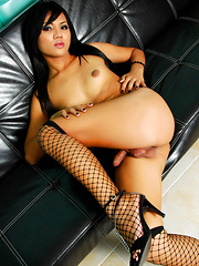 Stunning femboy from Thailand has heavy balls and a sweet cock