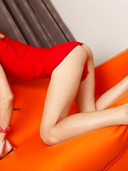 Slim and sexy Tgirl Lilly modelling her red dress while touching her body and slowly undressing to titillate her man. Sh