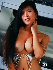 A Brunette Asian Tranny with a beautiful face shows off her body
