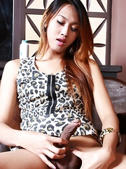 Nude Ladyboy Nhica plays with her very erect cock