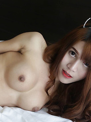 18 year old sexy Thai with long red hair and busty ladyboy strips