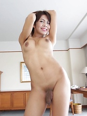 Wild busty Thai Ladyboy with big penis extracts foreign cum